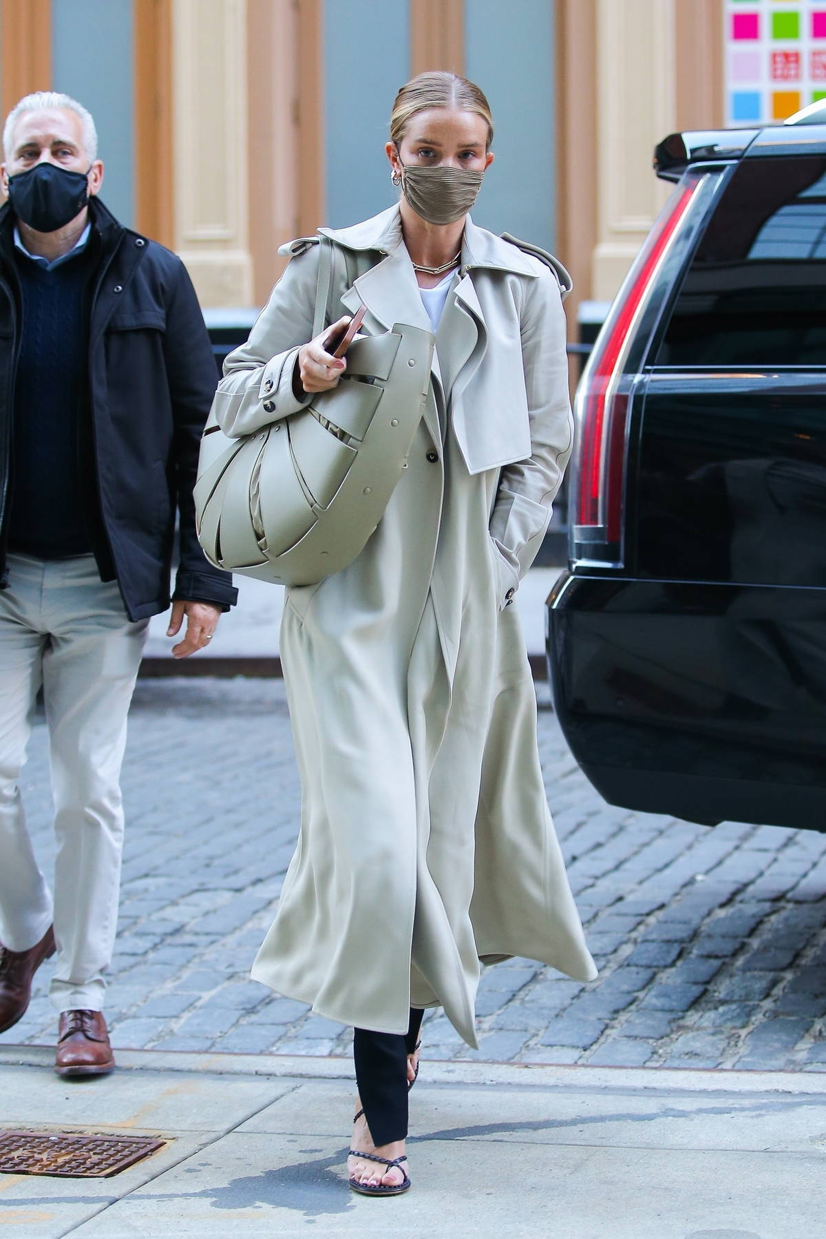Rosie Huntington-Whiteley looks chic in trench coat while for breakfast in New York City