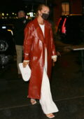 Rosie Huntington-Whiteley looks stylish in a long leather coat over an all-white ensemble while out for dinner in New York City