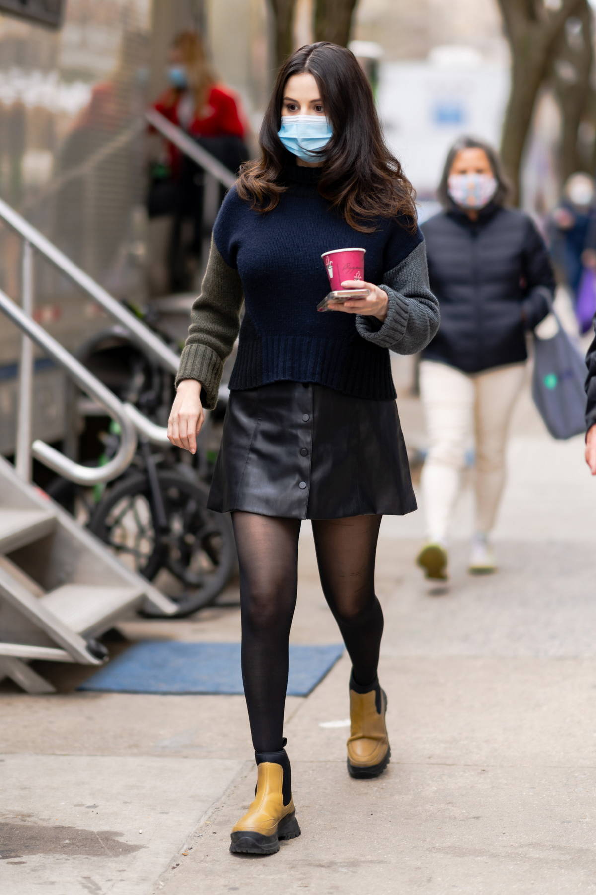 Selena Gomez wears a sweater and black leather jacket as she arrives on the set of 'Only Murders in the Building' in New York City