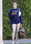 Shanina Shaik wears a Chanel sweatshirt with cream leggings for a morning Pilates class in West Hollywood, California