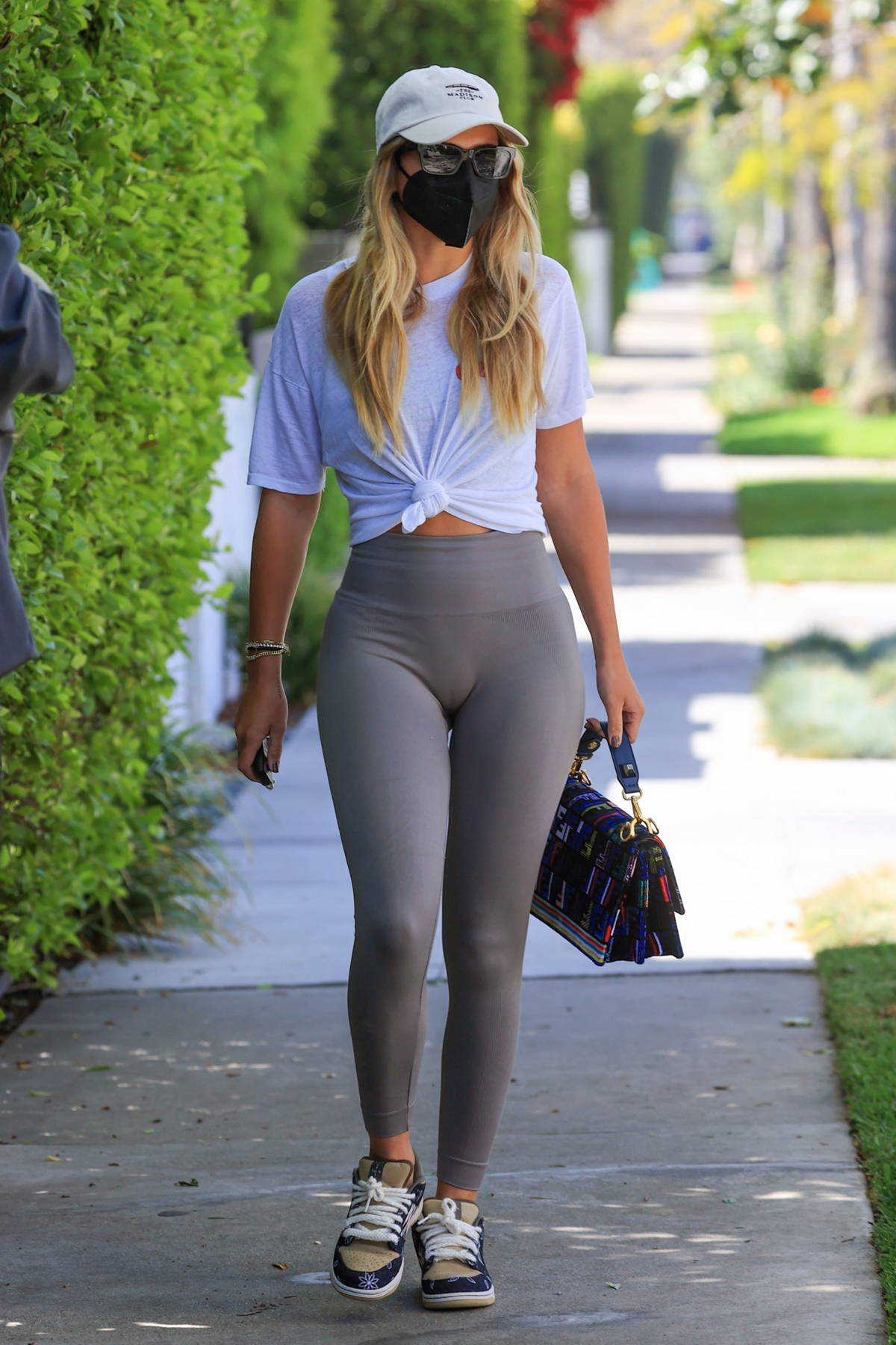 Sofia Richie shows off her toned legs in grey leggings as she attends a Pilates class in West Hollywood, California