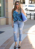 Sofia Vergara wears a blue animal print blouse and skin-tight jeans as she arrives at AGT taping in Los Angeles