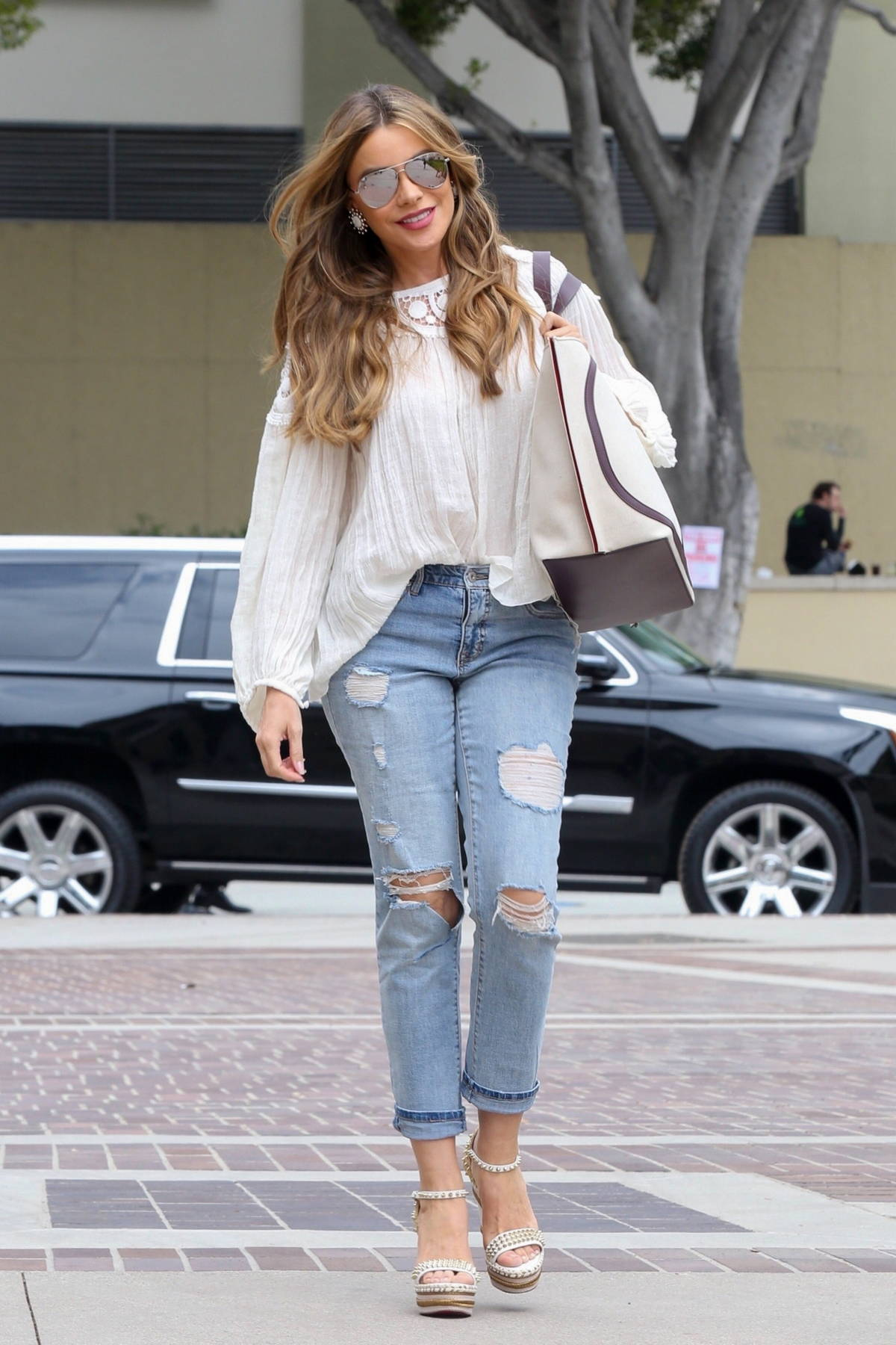 Sofia Vergara wears a white top and jeans as she arrives at a taping for AGT in Los Angeles