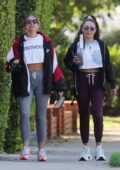 Vanessa Hudgens keeps it comfy in a jacket , cropped tee, and joggers while out for a stroll with BFF GG Magree in Los Angeles