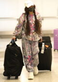 Vanessa Hudgens seen wearing an oversized tie-dye sweatsuit as she touches down at LAX airport in Los Angeles