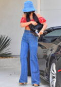 Vanessa Hudgens shows off her retro style while visiting a friend in her Lamborghini in West Hollywood, California