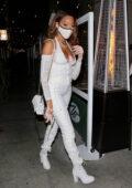 Winnie Harlow looks sensational in all white as she arrives for dinner in Beverly Hills, California