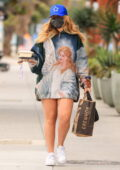 Addison Rae flaunts her legs in an oversized sweatshirt while picking up lunch and groceries at Erewhon in Los Angeles