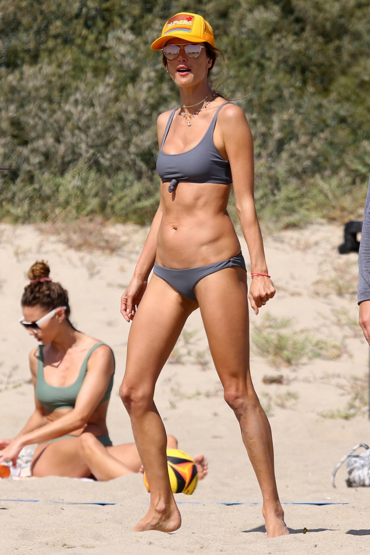 Alessandra Ambrosio flaunts her flawless figure in a grey bikini during a beach volleyball game in Malibu, California
