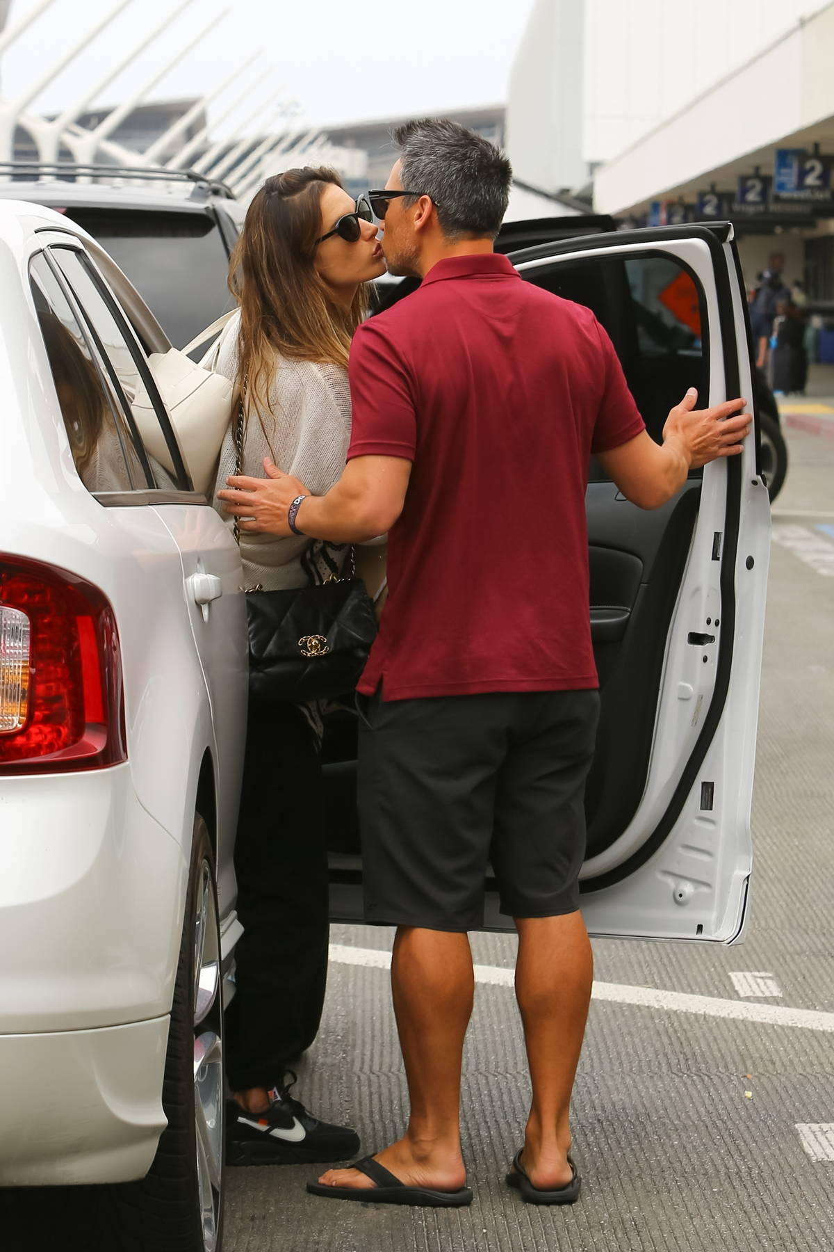 Alessandra Ambrosio kisses her boyfriend Richard Lee goodbye as he drops her off at LAX in Los Angeles