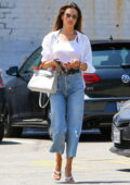 Alessandra Ambrosio looks cool in a white top and shirt with blue jeans while out for lunch with friends in West Hollywood, California