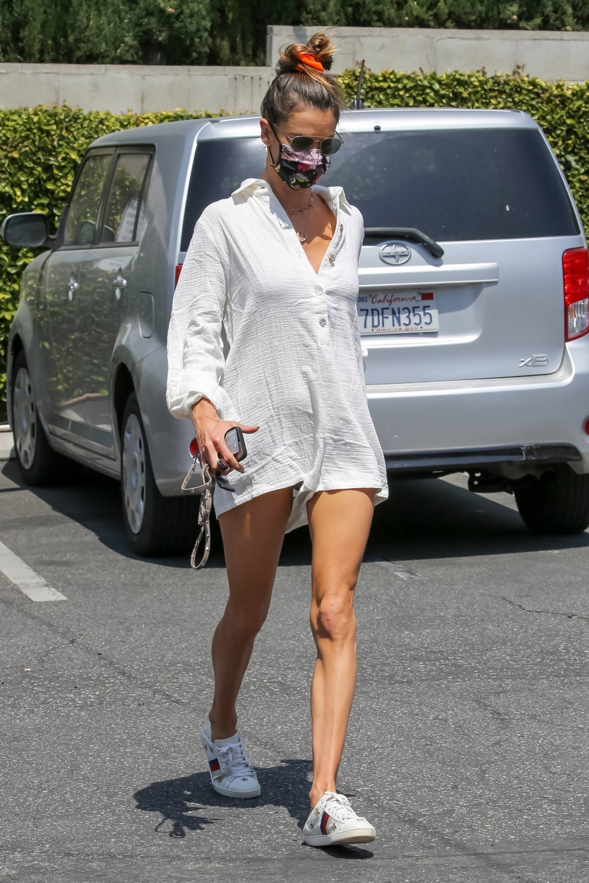 Alessandra Ambrosio shows off her slender legs in a white romper while out for lunch at Kreation Organic in Santa Monica, California
