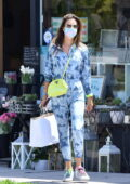 Alessandra Ambrosio sports a blue tie-dye jumpsuit while visiting a Cryotherapy wellness center in Santa Monica, California
