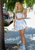 Alexis Ren looks cute in a cropped tee and a white short skirt as she steps out with her pup in West Hollywood, California