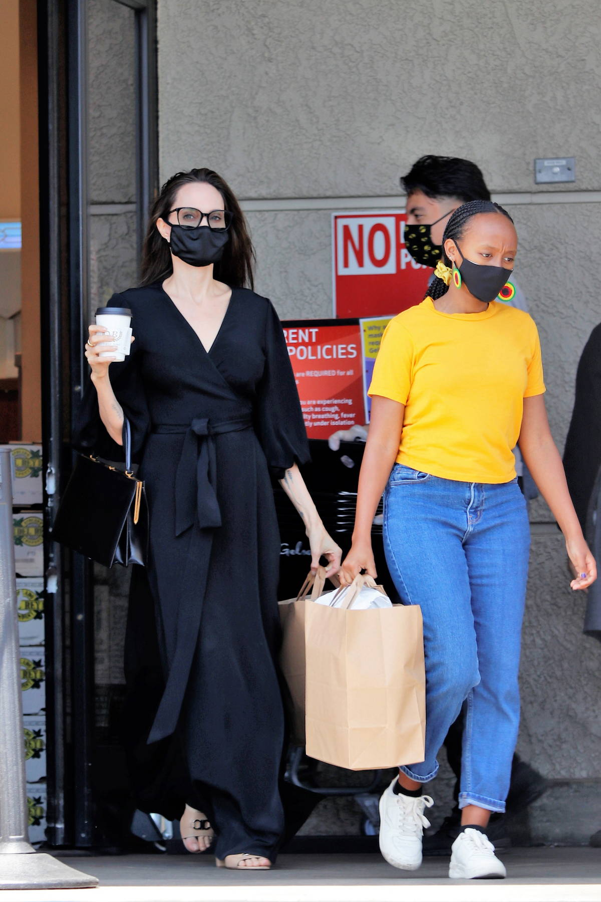 Angelina Jolie looks chic in a black maxi dress while out shopping with her daughter Zahara in Los Angeles