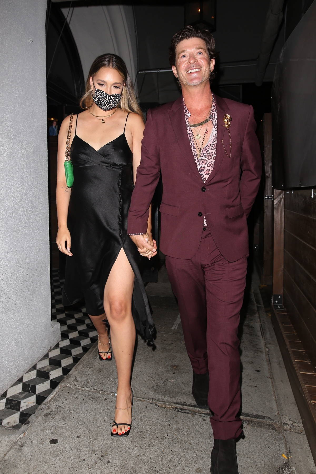 April Love Geary and Robin Thicke hold hands as they leave after dinner at Craig's in West Hollywood, California