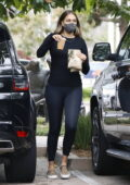 April Love Geary dons black top and leggings while stopping by a Starbucks in Malibu, California