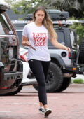 April Love Geary dons white tee and black leggings while out with her daughters in Malibu, California