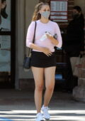 April Love Geary flaunts her legs in a black tennis skirt paired with a pink top while stopping by CVS Pharmacy in Malibu, California