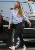 April Love Geary wears a grey hoodie and black leggings as she goes grocery shopping at Pavilions in Malibu, California