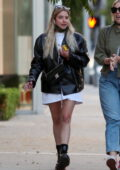 Ashley Benson enjoys a stroll with a friend after a bite at Zinque restaurant in West Hollywood, California