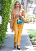 Ashley Benson looks striking in yellow as she heads to a business meeting in Hollywood, California