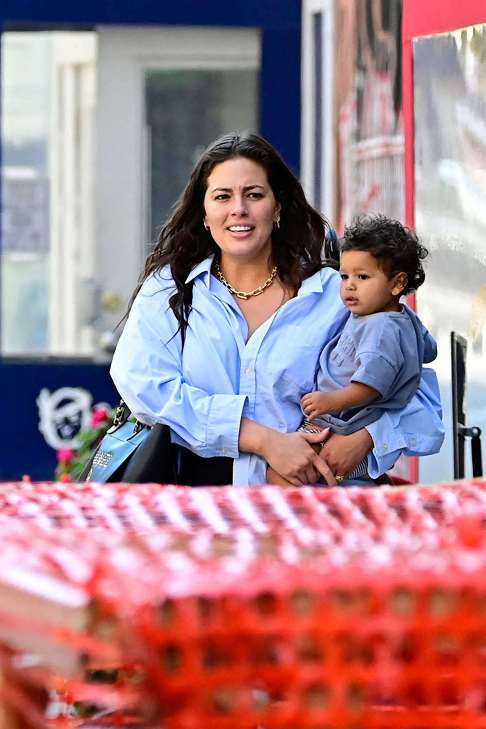 Ashley Graham carries her son as she leaves a restaurant in New York City