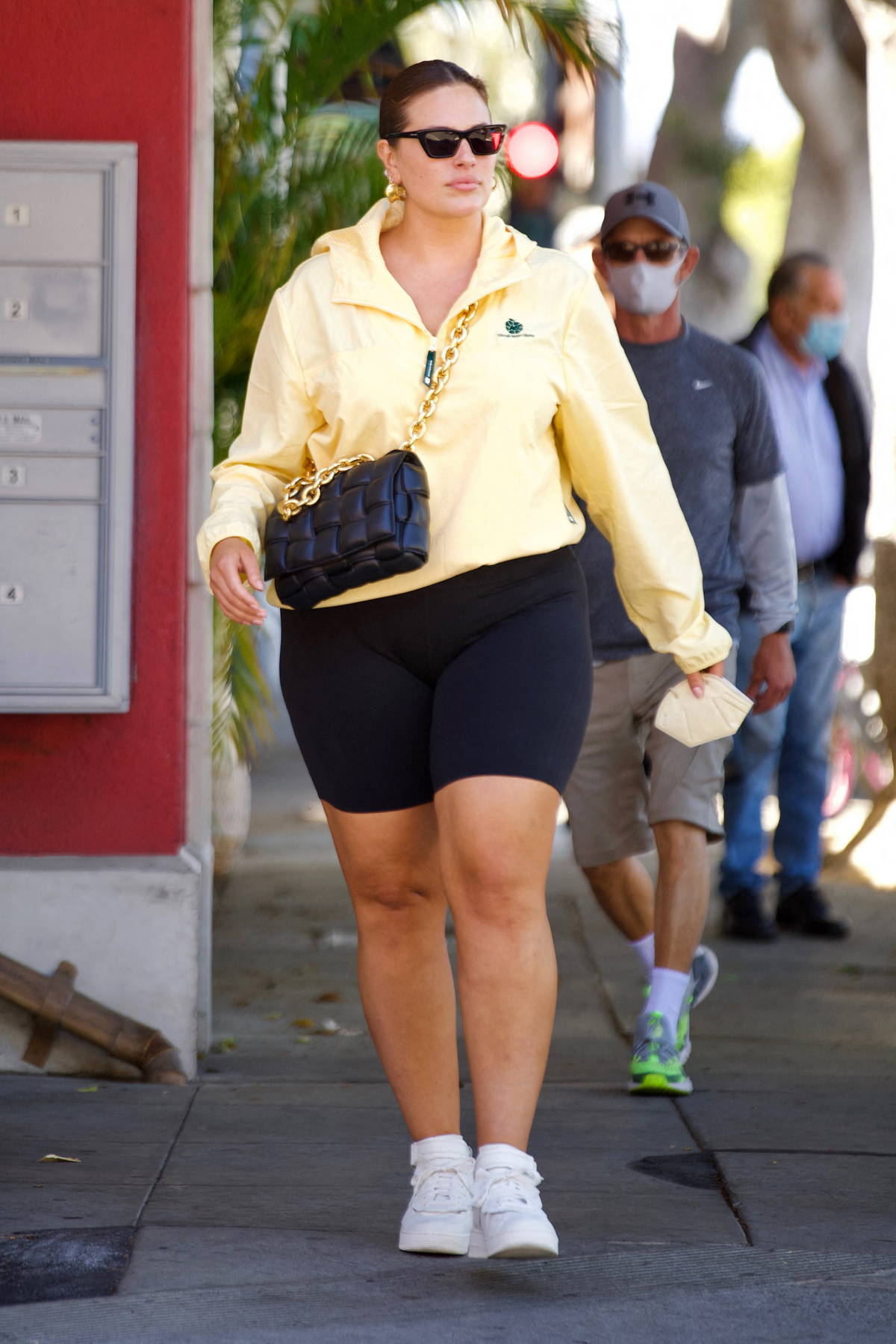 Ashley Graham flaunts her curves in legging shorts and yellow windbreaker while out in Santa Monica, California