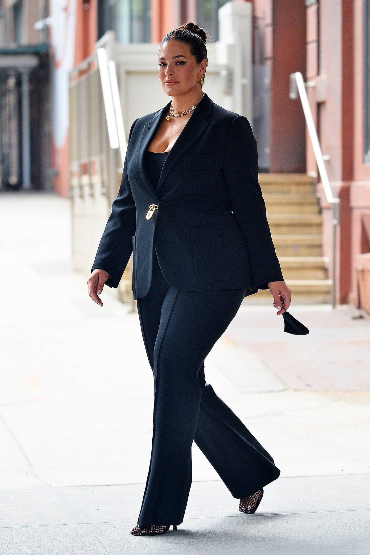 Ashley Graham looks sharp in a black pantsuit as she steps out in New York City
