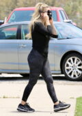 Avril Lavigne shows off her curves in a tight black top and camo leggings while making a stop at Crystals store in Malibu, California