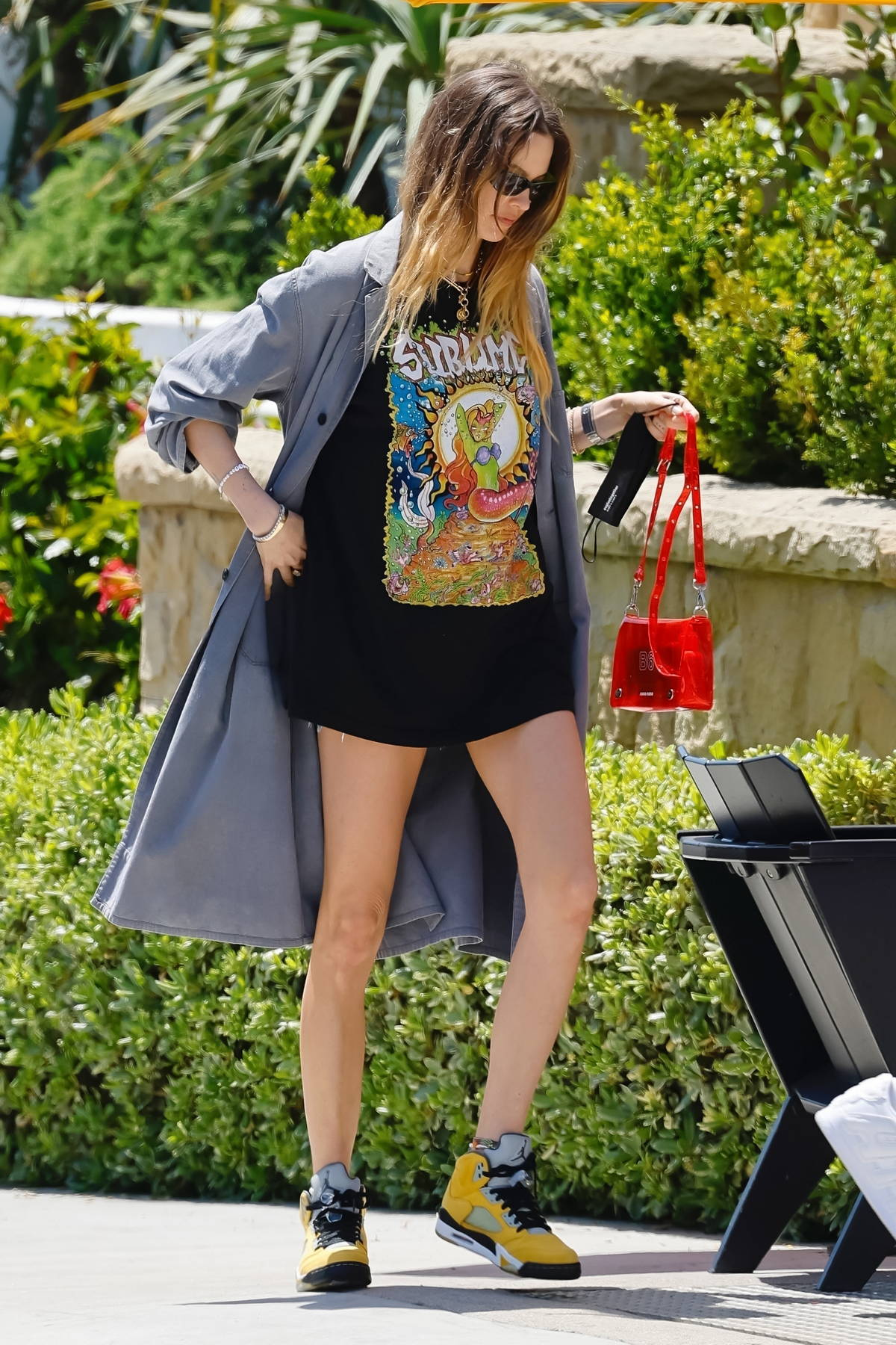 Behati Prinsloo and Adam Levine display their colorful style while out with Adam's dad in Montecino, California
