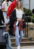 Behati Prinsloo shows off her flat abs as she steps out for lunch with Adam Levine in Santa Barbara, California