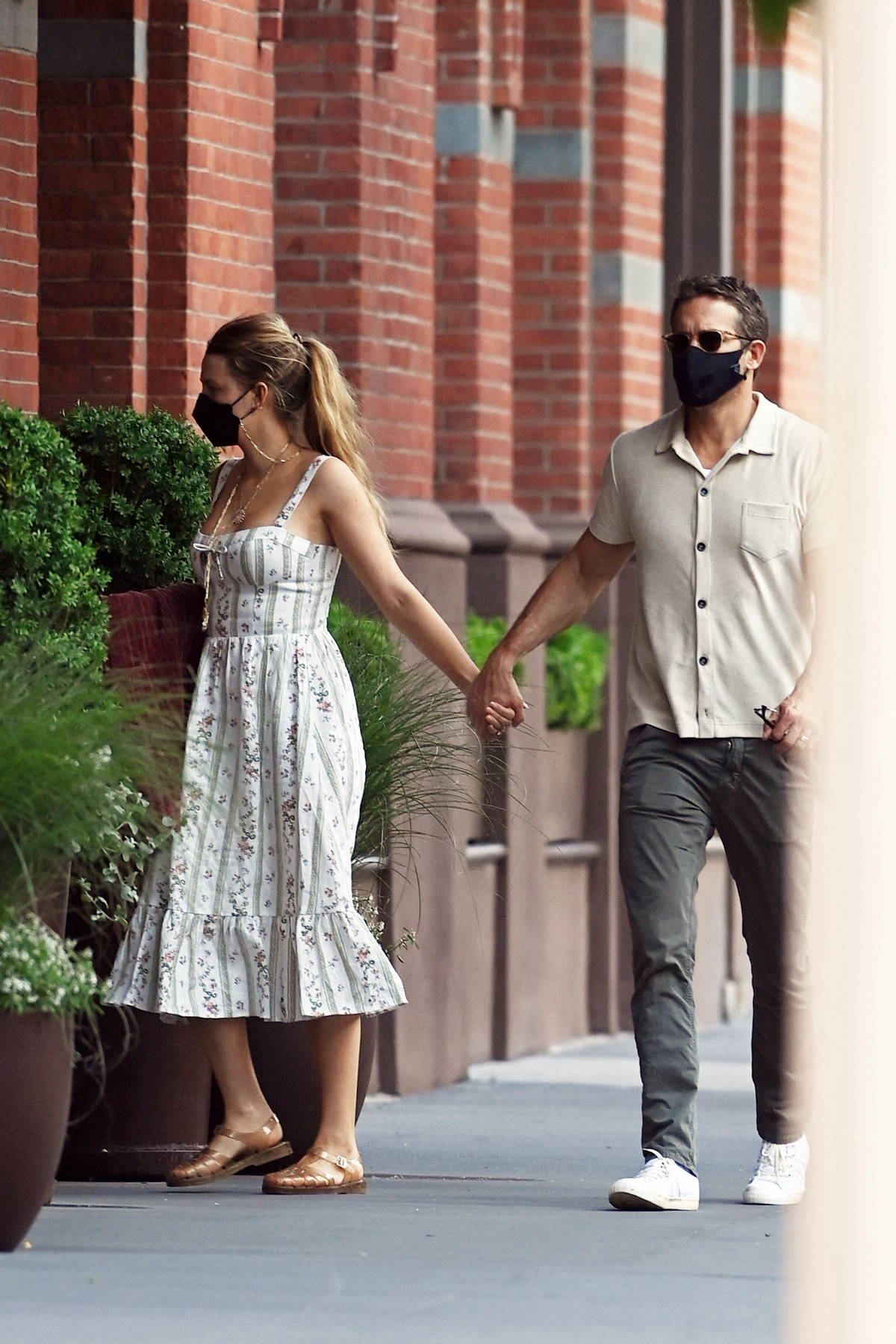 Blake Lively and Ryan Reynolds hold hands as they arrive back after dinner in New York City