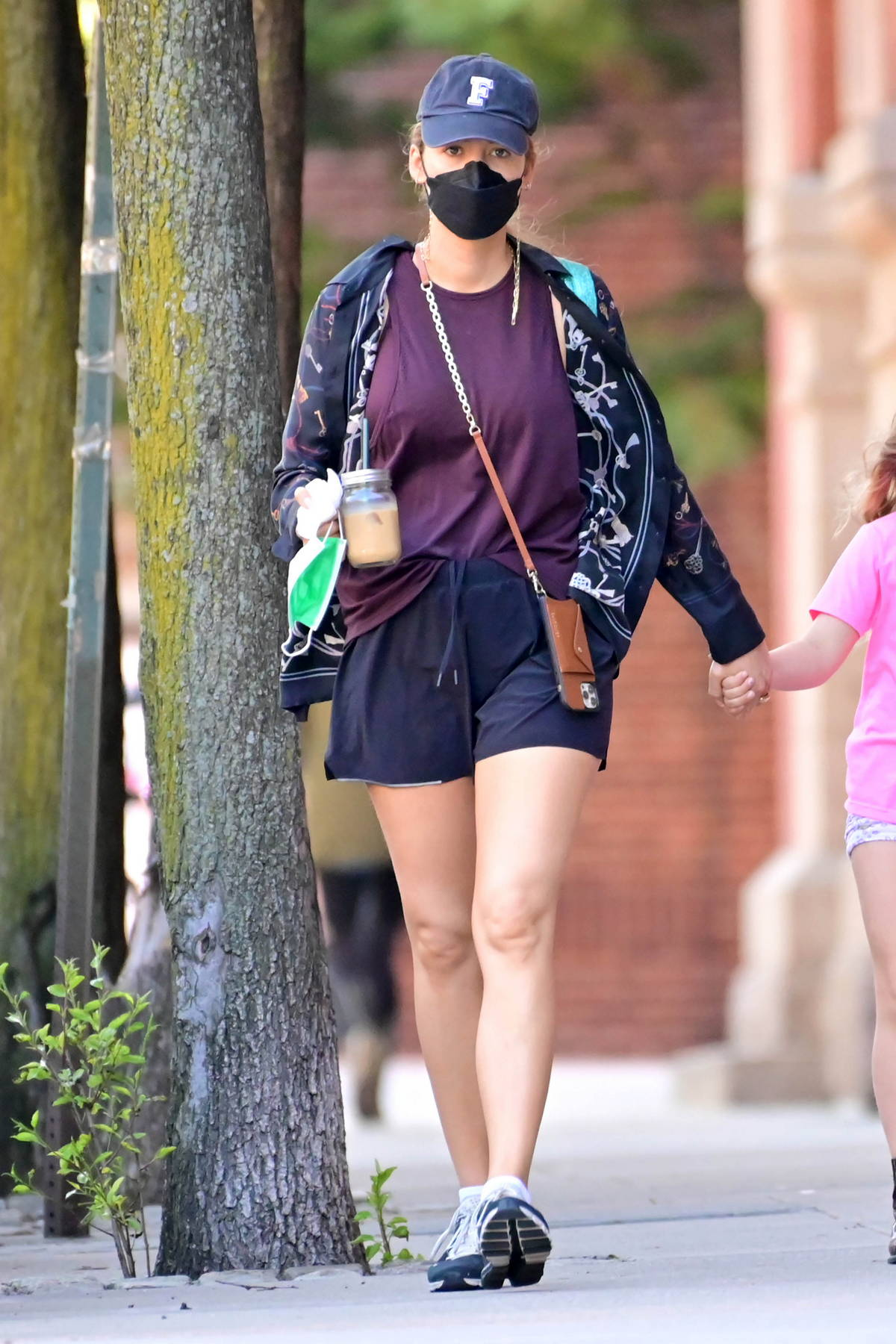 Blake Lively keeps it casual in a burgundy tee with gym shorts while stepping out with her daughter in New York City