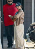 Camila Cabello looks cute in oversized baggy pants and a crop top while getting her nails done with a bodyguard in West Hollywood, California