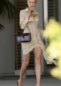 Charlotte McKinney looks fab in a form-fitting beige dress while running a few errands in Los Angeles
