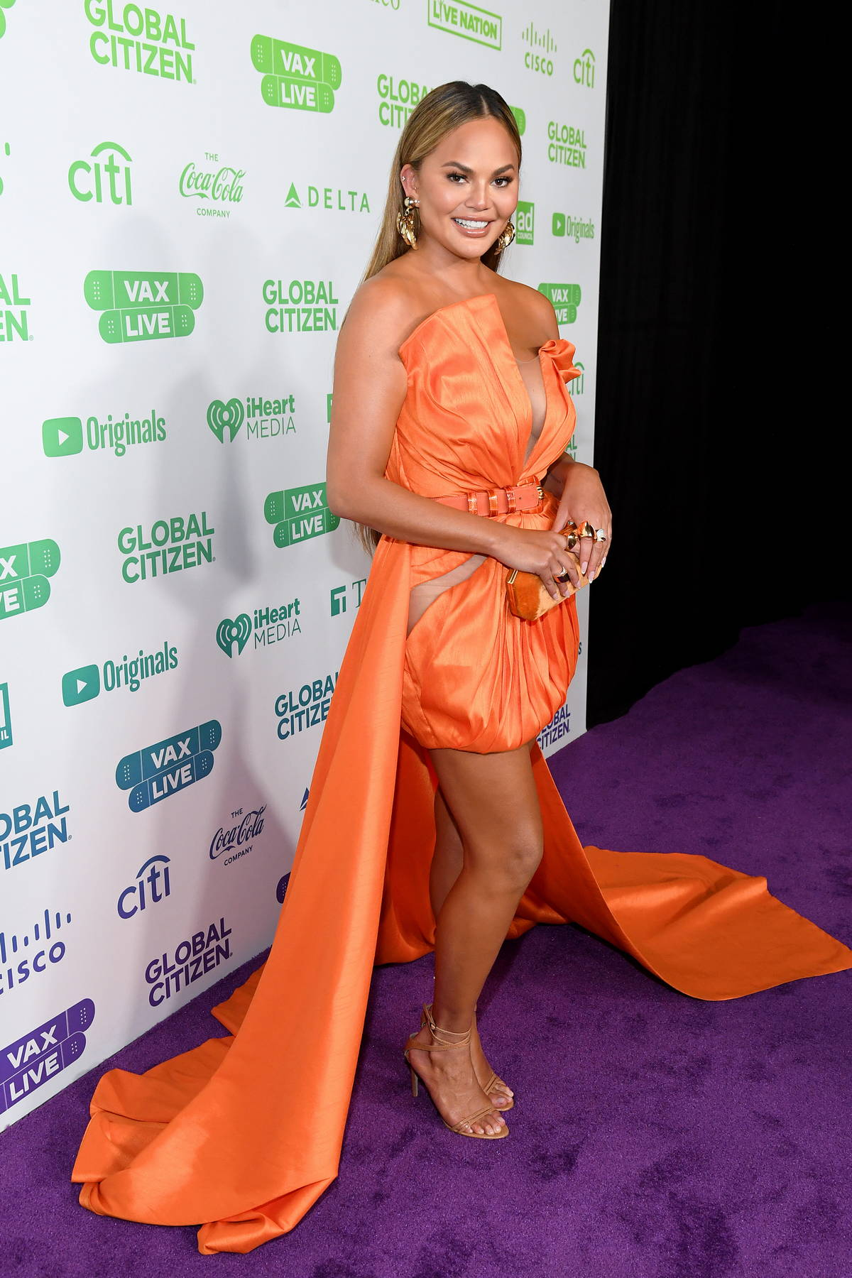 Chrissy Teigen attends Global Citizen Vax Live: The Concert to Reunite the World at SoFi Stadium in Inglewood, California