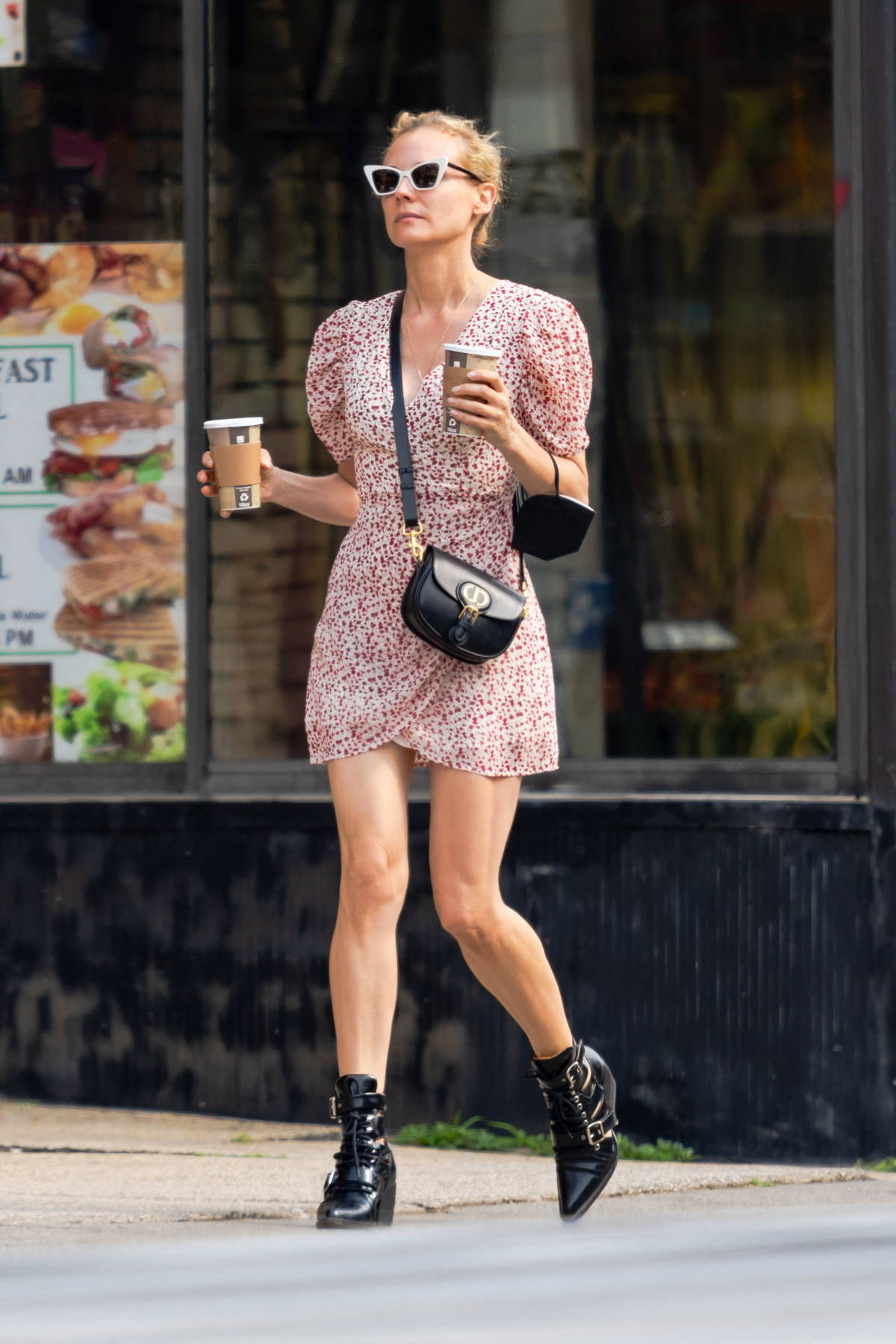Diane Kruger looks great in a patterned mini dress while out for a stroll with a friend in New York City