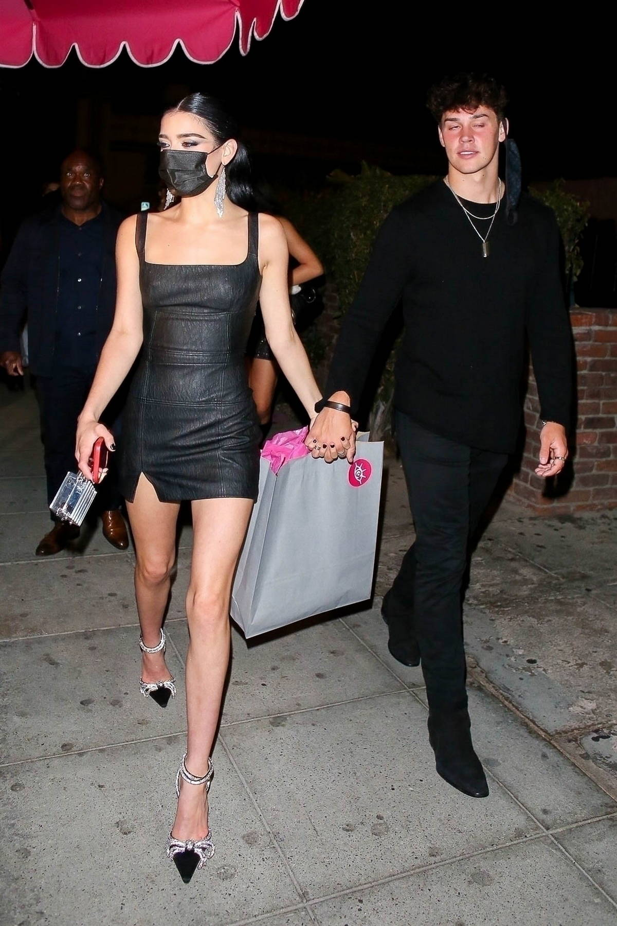 Dixie D'Amelio flaunts her legs in a black mini dress as she leaves her sister Charli's birthday party at Delilah in West Hollywood, California