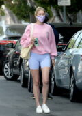 Elsa Hosk sports a pink sweatshirt and blue shorts as she grabs juice before heading to the gym in West Hollywood, California