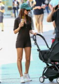 Emily Ratajkowski shows off her slender legs in a brown romper as she takes her baby out for a stroll with friends in New York City