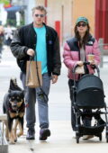 Emily Ratajkowski wears a pink North Face puffer jacket for a walk with her husband and their baby boy in New York City