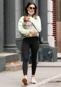 Emily Ratajkowski wraps her arms around her baby while out for a stroll with her husband in Tribeca, New York