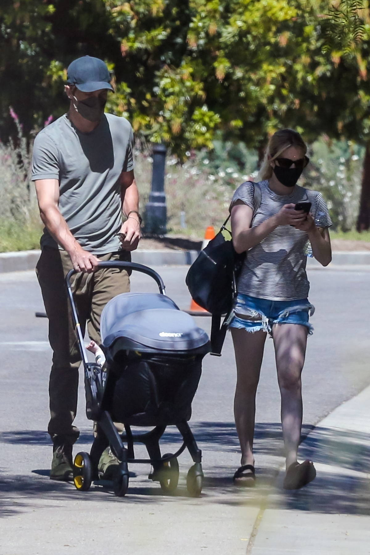 Emma Roberts and Garrett Hedlund step out for a stroll with their baby in Pasadena, California