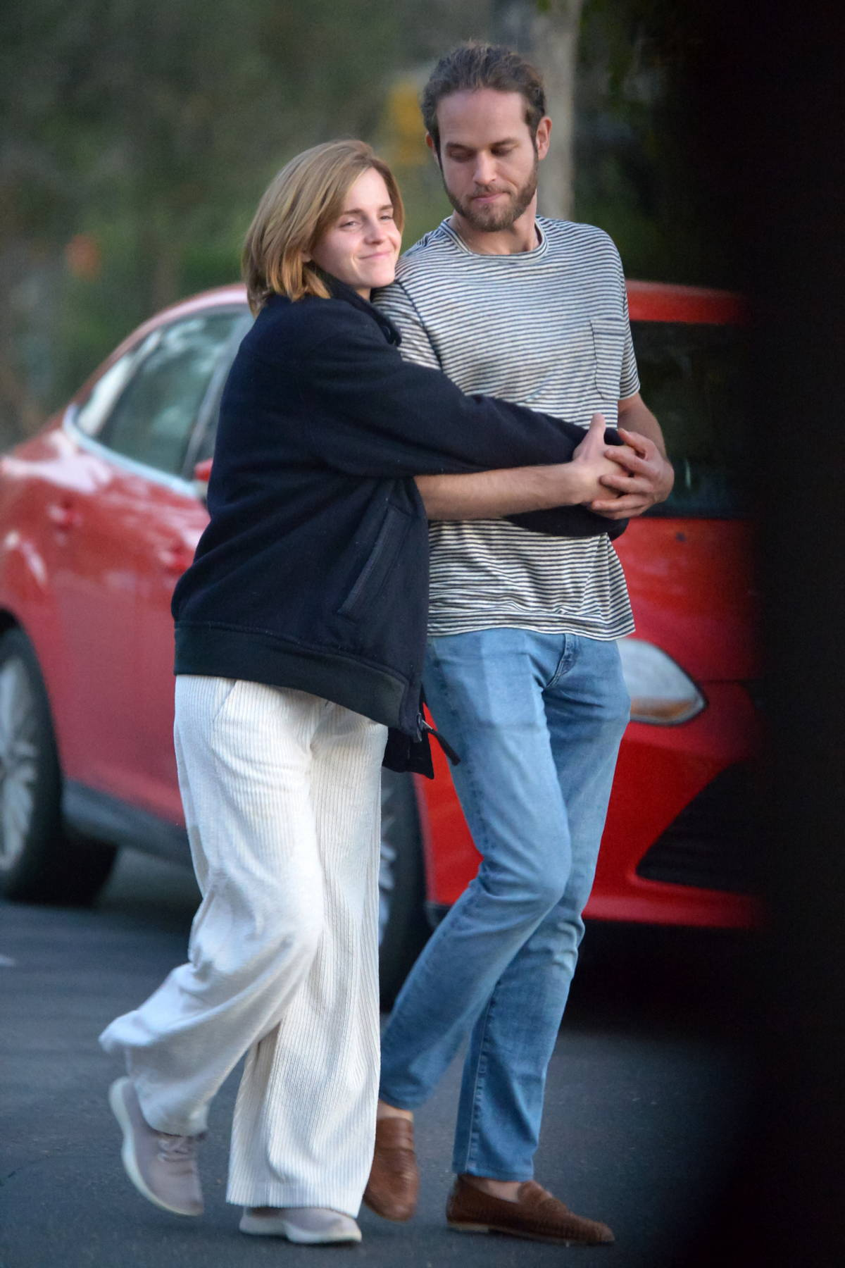 Emma Watson and beau Leo Robinton pack on the PDA during a romantic stroll in Los Angeles