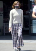 Emma Watson dresses down in checkered pants while stopping by a CVS with boyfriend Leo Robinton in Los Angeles