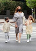 Eva Mendes gets dressed in a Spring dress while out with her girls in Los Feliz, California