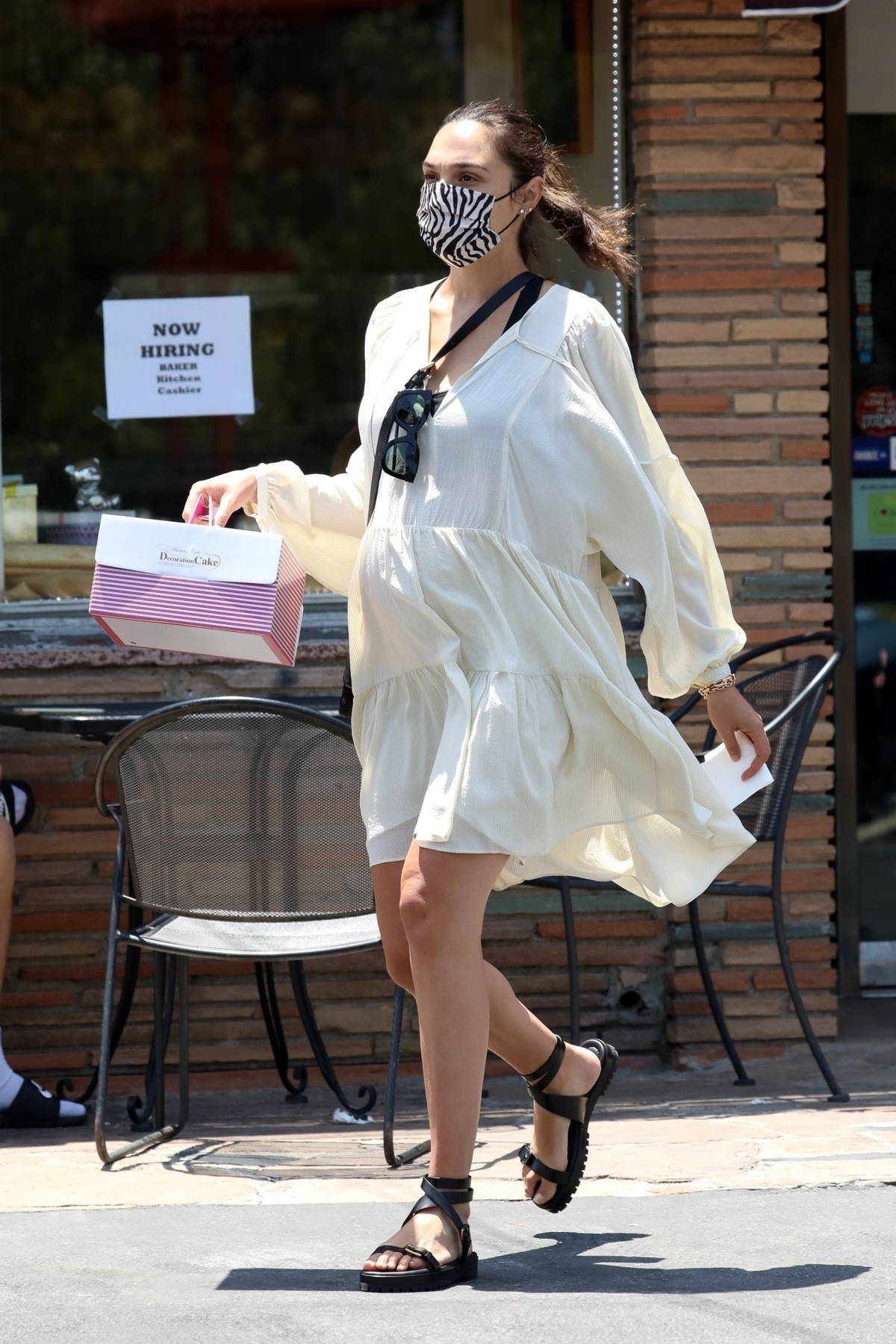 Gal Gadot looks radiant in a flowing off-white dress while making a stop at a local bakery in Los Angeles