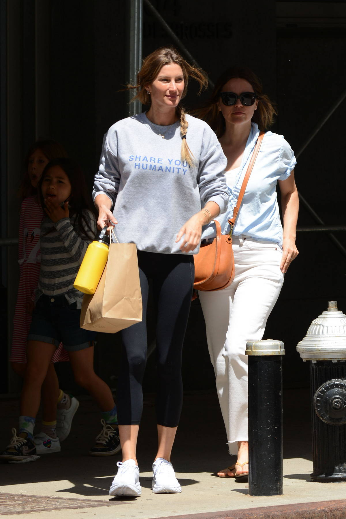 Gisele Bundchen keeps things casual in a sweatshirt and black leggings during a rare outing in New York City