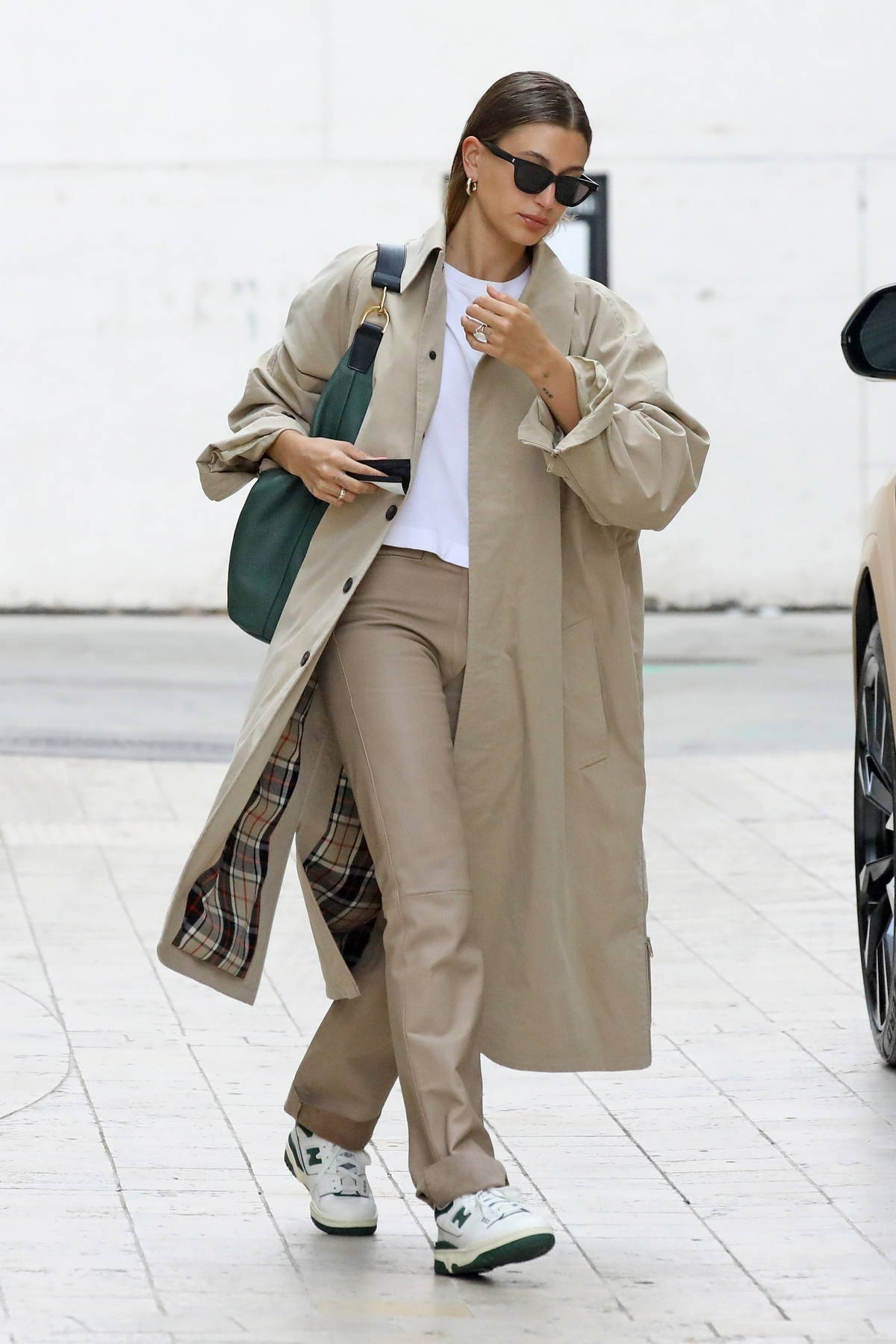 Hailey Bieber looks chic in a Burberry trench coat as she heads to a meeting in Los Angeles